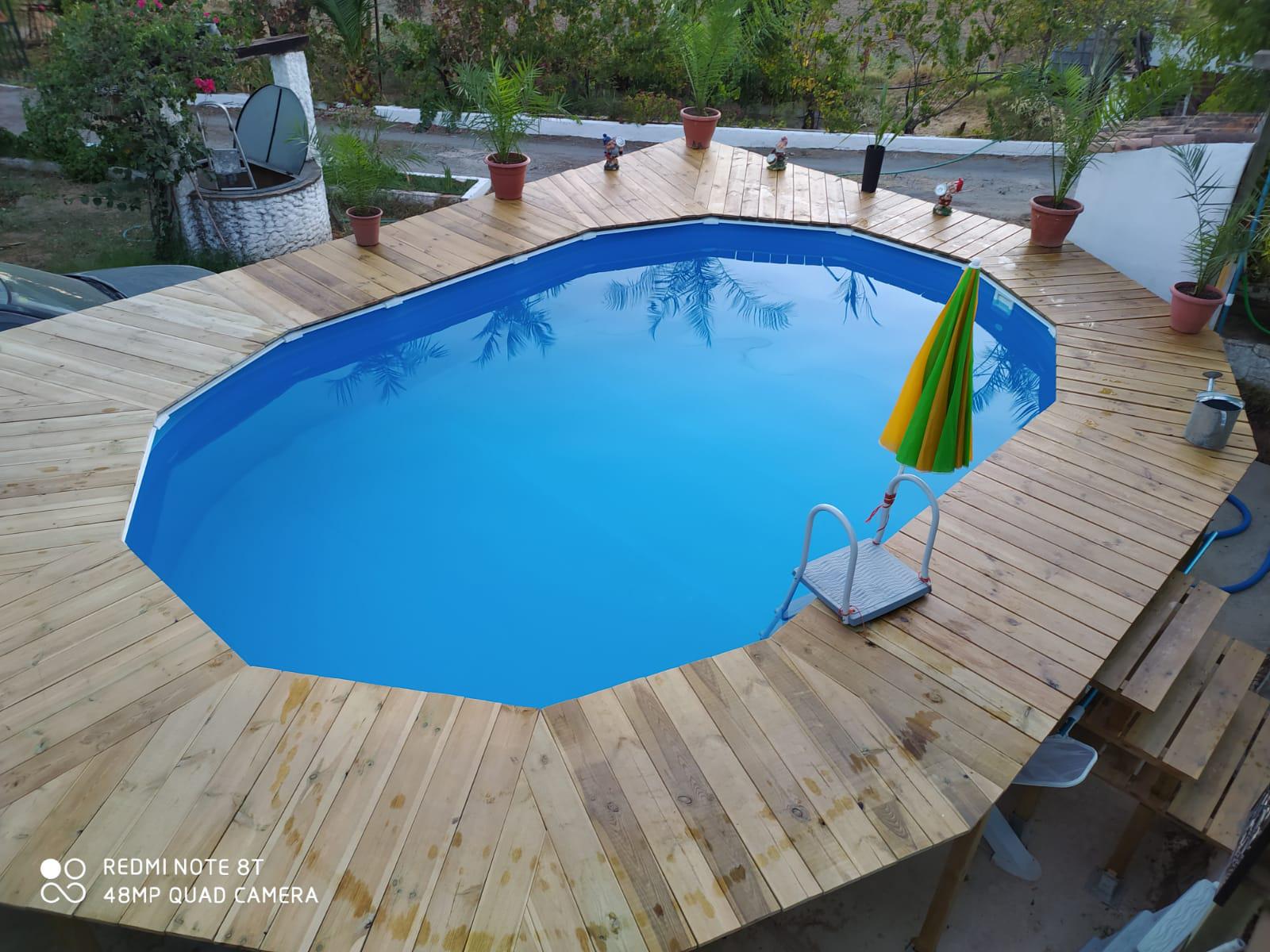Cubierta para piscina de madera y a medida